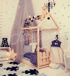 This toddler bed house is an amazing place for children where they can sleep and play in child bedroom interior. This adorable floor bed will make transitioning for toddler from a crib to a bed smoothly. Bed is designed following Montessori principles of independence – building,