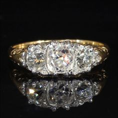 Spectacular 3 Stone Diamond Victorian Ring with 1 carat center stone, from Vsterling on Ruby Lane.  2ctw 15k and Platinum, c. 1880.