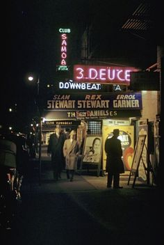 Tourists wander past Club Samoa, Club Downbeat and 3 Deuces in Times Square. (The south side of Street, between & Avenues – looking east from Avenue) Photo: Andreas Legendary jazz clubs. Jazz Bar, New York Night, Neon Nights, Vintage New York, Color Photography, Travel Photography, Neon Lighting, Vintage Photographs, Night Life