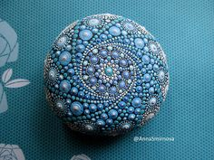 Jewel Drop Mandala Sea Stones. This stone is approximately 10cm in diameter The weight of the stone 468 grams These one of a kind treasures are an absolute joy for me to create. I find these splendid, smooth round stones on beaches and take off where nature left it. The stones have not be altered or shaped by human means at all. Finding these stones is a time consuming process which adds to their rare and unique quality. I have lovingly hand painted this special stone with acrylic paints…
