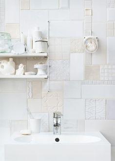 Mix tile patterns for a backsplash or wall.