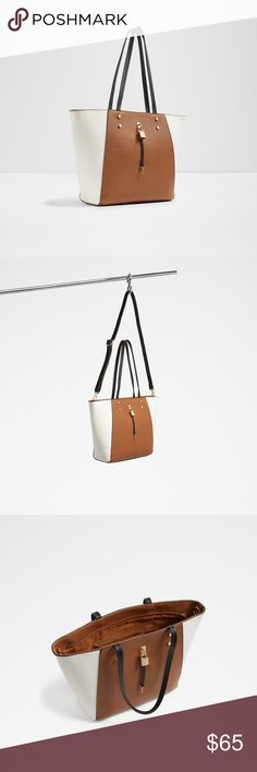 """Aldo Ulaun Tote Lock and key tote features light gold hardware that pops against a solid color, two texture backdrop of faux- leather and fabric. Geometric and structured, this large tote looks great on the arm. Details  synthetic Imported synthetic lining zipper closure 10"""" shoulder drop 11.5"""" high 10.75"""" wide strap drop: removable strap has a drop of 23.5 inches and a length of 50.5 inches inches; pockets: 3 slip, 1 zip, 1 exterior Aldo Bags Totes"""