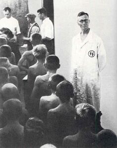 "An SS doctor examines a group of kidnapped Polish children  judged to be ""racially valuable"" and ready for adoption by German parents.  Süddeutscher Verlag, Bilderdienst, Munich"