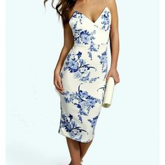 NWT blue and white floral dress Blue and white floral dress. New with tags still attatched, very stretchy, has blue rose pattern and thin straps. Says it is a US 10 but fits more of a medium 6/8. Ordered online from Australia .  Cheaper on merc Boohoo Dresses Midi