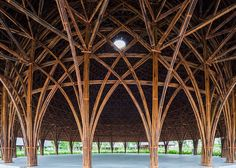 Vo Trong Nghia Architects has built a community centre of eight domed pavilions, each with intricate bamboo structures and thatched rooftops