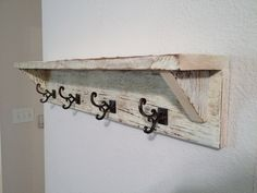 Reclaimed Barn Wood Coat Rack Shelf. This but stained with a walnut stain instead of white washed in my entryway.