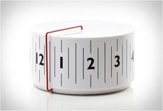 /analog clock that shows the time on a rotating cylinder /by Lexon