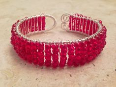 Red Beaded Wire Wrapped Bracelet, Red Bracelet, Red Wire Wrapped Bracelet by PastNPresentsByAlana on Etsy https://www.etsy.com/listing/212612524/red-beaded-wire-wrapped-bracelet-red