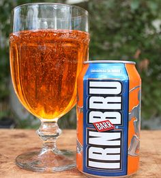 IRN BRU FOREVER...It is an orangey-rust coloured, fizzy, sweet Scottish soft drink. It tastes like a cross between bubble gum and cream soda.