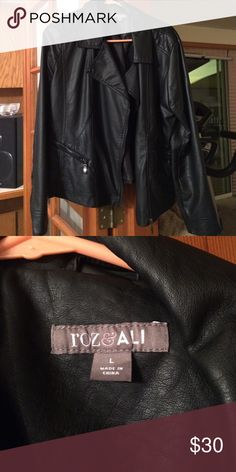 Black leather jacket Black leather jacket with side zipper and zipper pockets! Never worn! Jackets & Coats