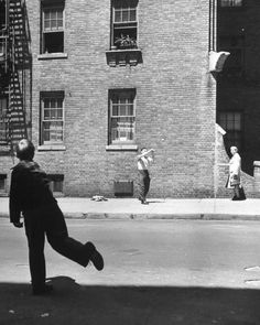 Boy hitting a ball during a game of stickball-NYC - Photo by Ralph Morse - 1944