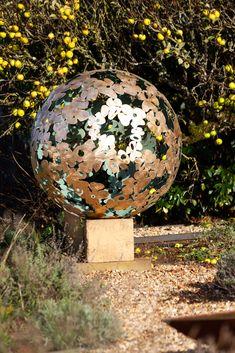 A diameter solid brass Garden sculpture sphere. The design is based on a Hydrangea flower, the choice of my client. Steel Sculpture, Garden Sculpture, David Murphy, Hydrangea Flower, Flowers, Solid Brass, Sculptures, Outdoor Decor, Design