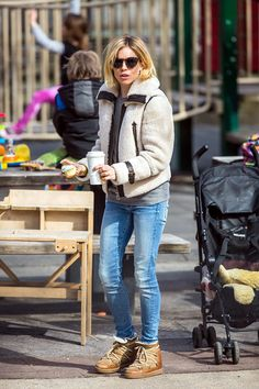 Sienna Miller in jeans, boots, shearling jacket.