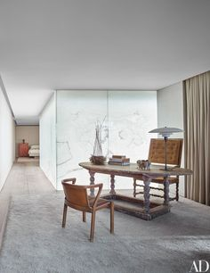 White onyx walls diffuse light in the master suite. Circa-1740 Swedish table; circa-1920 Alvar Aalto chair; circa-1770 Swedish armchair in Jill Dienst's duplex designed by John Pawson.