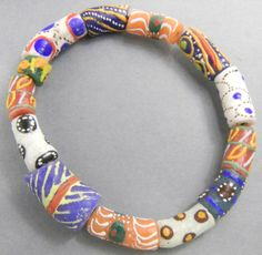 richly coloured bracelet of glass beads. The beads are painted in The Krobo-area in Ghana.