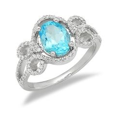 This bold ring boasts a look that holds vibrant beauty! Handcrafted in lustrous 14k white gold, this ring features a gorgeously elegant design with diamond accents leading up from the band in a swirl design showcasing the vibrant gemstone in the center. The featured gemstone is a genuine oval cut blue topaz gemstone held in a secure 4 prong setting. The color of the diamonds are H/I and the clarity is SI2/SI3.Different ring sizes may be available. Please inquire for details. $348.00 Blue Topaz Diamond, Diamond Gemstone, Diamond Rings, Gemstone Rings, Bold Rings, Ring Sizes, Swirl Design, Showcase Design, Clarity