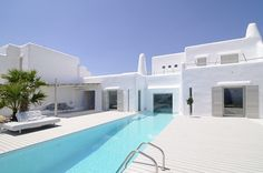 If It's Hip, It's Here: Paros Cyclades Greece House With Swimming Pool You Can Look Into From Inside The Home.