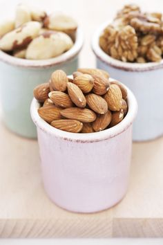Go nuts! They slim your tummy by keeping it full. A Purdue University study showed that people who ate nuts felt full longer than those who ate rice cakes. Stick to 24 almonds a day to satisfy your hunger pangs without overloading on calories. Watch out: Skip salted nuts; too much sodium raises blood pressure.  - GoodHousekeeping.com