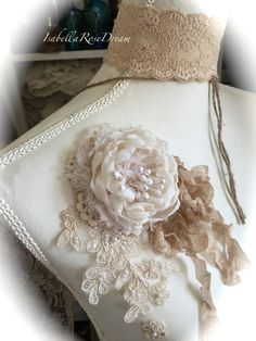 This beautiful, romantic, shabby chic style true handmade flower decorated with lovely appliqué and tale of ribbons and lace. Size of the set apprx 7 1/2 L These roses made from cream color chiffon type fabric. Every petal was carefully handcrafted and stitched together by my hands. Rose,appliqué and ribbons are set on a lovely antique little doily. This flower set can be use as a pin to decorate dress, gift box, pillow and etc (just add simple safety pin in the back), home decor, we...