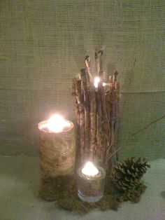 Eagle Scout ceremony centerpiece.  Hot glues sticks, bark and moss to aluminum cans.  So easy and super inexpensive.  Fill votives with pebbles, add pinecones, acorns, big chunks of bark and voila!