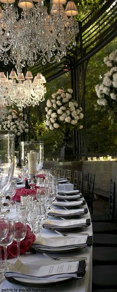 Gorgeous crystal chandeliers, giant hanging baskets and large hurricane pillar candle holders reception decor
