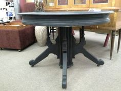$139 - This solid wood Victorian table has an ornate base on 5 Wheels. It has been painted black, lightly distressed and finished with a tinted wax. The table measures 43 inches in diameter and stands 30 inches tall. It can be seen in booth D12 at Main Street Antique Mall 7260 East Main St ( E of Power Rd ) Mesa 85207  480 9241122open 7 days 10 till 530 Cash or charge 30 day layaway also available