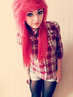 Hot pink scene hair; lip piercing; red plaid flannel shirt; black fish tights