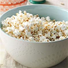 Ranch Popcorn Recipe -What's a night at the movies without popcorn to munch? Try a big tub of our Test Kitchen's buttery, showstopping blend. It's easy, Parmesan cheesy and finger-lickin' good!
