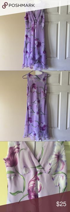 Giorgio Fiorlini Dress This is a purple, floral Giorgio Fiorlini dress in size 6. It is in excellent condition without stains, marks, holes, or signs of wear. Machine wash and line dry. Giorgio Fiorlini  Dresses