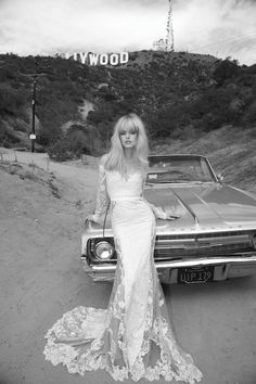 love the sheer panels on this wedding dress by Inbal Dror