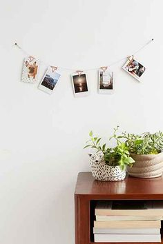 I love how the clips become part of the art with this Copper Photo Clip Banner - Urban Outfitters #UOonCampus #UOContest