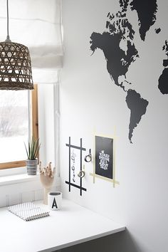 DIY your workspace decor with some washi tape and prints (p.s. awesome map decal on the wall)
