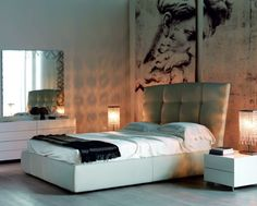Sensational contemporary platform bed with button detail and padded structure. A striking combination of luxury and the flair so synonymous with Cattelan Italia. The slanted, leather upholstered headboard is both striking and innovative and is available in a wide variety of colours and finishes including soft, top grain Italian leather and eco leather.