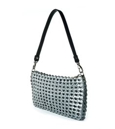 "Petite clubbing bag with elegant finishing. Silver monogrammed fabric liner, metal zipper closure. One inside zipped pocket. Size: 10"" L x 5"" H x 1"" D Strap: black leather 18.5"" L with detachable clas"