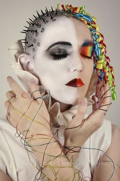 a take on Delirium: I don't know about all that on the left, but the makeup & ribbon curls on the right are interesting.