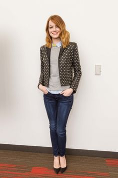 Fitted/structured blazer. Well-fitting jeans. Light grey sweater. Pop of yellow. Pointed shoes. Youthful and professional.