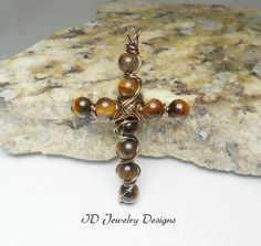 Wire wrapped Tigers Eye stone Cross Pendent by IDJewelryDesigns
