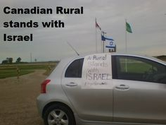 Toyota Yaris with Canadian rural stands with Israel placard in Wheatland County, AB (Canada).