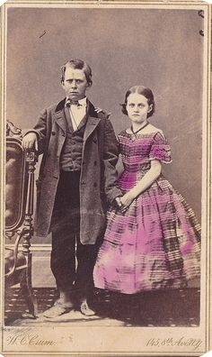Boy in double-breasted frock, with girl  circa 1860s