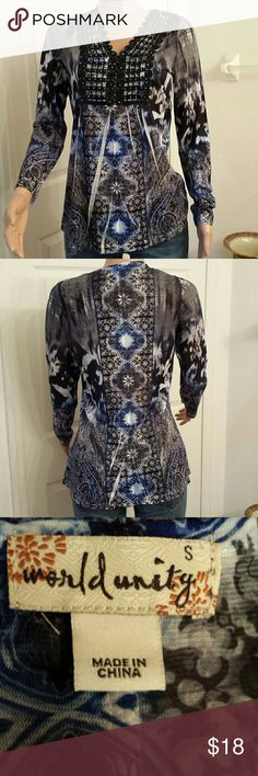 World unity small top This is a beautiful top. Mint condition. world unity  Tops