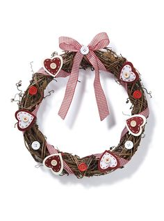 Let your lucky visitors know that you love them Christmas with a warm welcome from this cute Nordic hearts twig wreath idea, with step-by-step instructions.