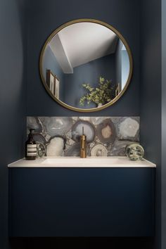 Stone-Cold Stunner A gorgeous backsplash that features a cross-section of agate stone pops against the dark blue of the vanity and the walls in this minimalist London powder room by dk Interiors. Blue Bathroom Vanity, Half Bathroom Decor, Half Bathroom Remodel, Bathroom Ideas, Bathroom Vanities, Bathroom Remodeling, Kitchen Decor, Houzz Interior Design, Interior Design Awards