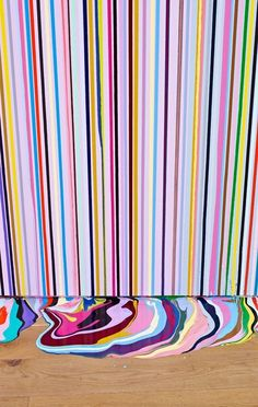 """Once the youngest nominee for the Turner Prize, Ian Davenport creates his """"syringe art"""" by squirting glossy paint onto canvas and allowing gravity to determine the final composition."""