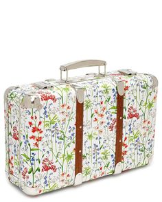 Traveling in style with this crush-worthy Liberty of London floral-print suitcase.