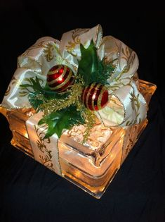 Items similar to Gift wrapped lighted glass block, cream bow with red/gold ornament accents. on Etsy Painted Glass Blocks, Decorative Glass Blocks, Lighted Glass Blocks, Christmas Centerpieces, Xmas Decorations, Christmas Glass Blocks, Christmas Ornaments, Christmas Projects, Holiday Crafts