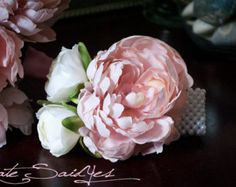 peony corsage wrist, but in coral and white