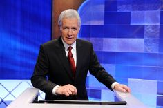 """George Alexander """"Alex"""" Trebek (July 22, 1940 - ) Canadian American television personality. He has been the host of the syndicated game show Jeopardy! since 1984."""