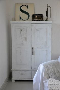 on a shabby white cupboard