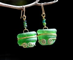 Green Sea Glass Earrings Wire Wrapped Bottle Top Glass Earrings. by HKart1 https://www.etsy.com/il-en/listing/179849650/green-sea-glass-earrings-wire?ref=shop_home_active_1