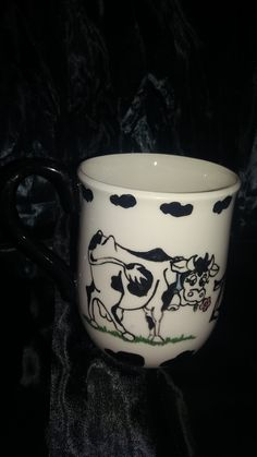 Cow coffee mug hand painted for a client who loves cows.
